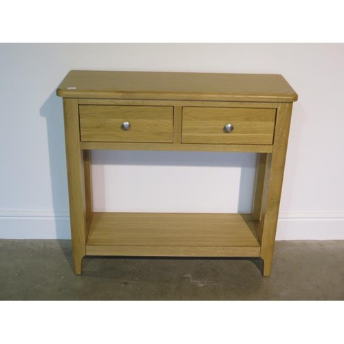24a - An ex-display Nordic oak two drawer console table - 90cm W x 30cm D x 83cm H...