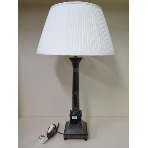 10 - A painted table lamp with a shade, 75cm tall