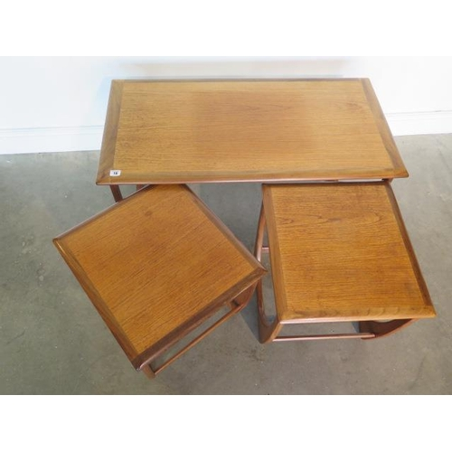 18 - A nest of three G plan side tables, 51cm tall x 99cm x 49cm, in generally good condition with some s...