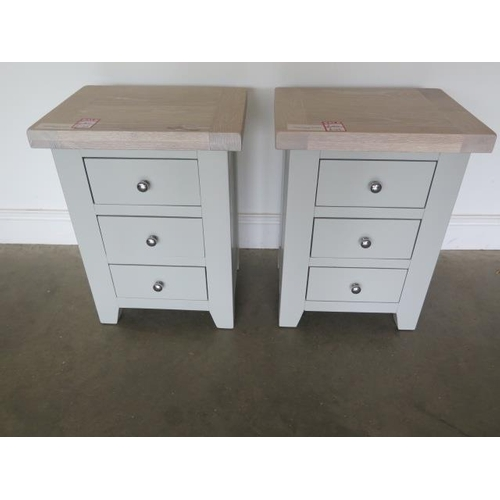 24 - A pair of painted three drawer bedside chests with chalked oak tops, 62cm high x 47cm wide, ex-displ...