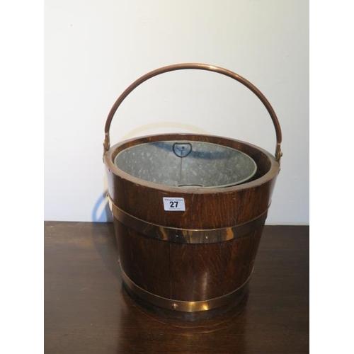 27 - A brass bound oak bucket planter, 45cm x 33cm diameter, in good condition
