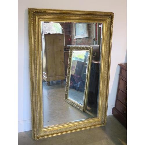 29 - A large gilt over mantle mirror, 144cm x 97cm