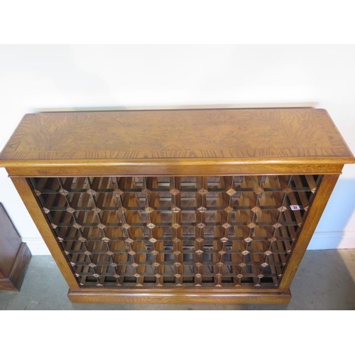 32 - A burr oak 80 bottle wine rack made by a local craftsman to a high standard, 98cm tall x 111cm wide ...