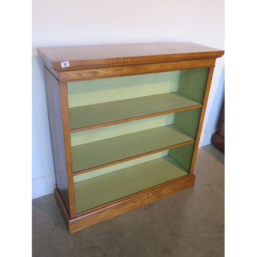 33 - A burr oak open bookcase with two adjustable shelves and painted interior made by a local craftsman ...