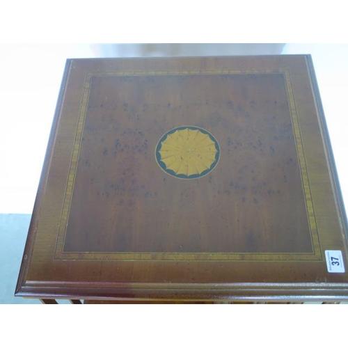 37 - A burr yew effect revolving bookcase, 81cm tall x 47cm x 47cm