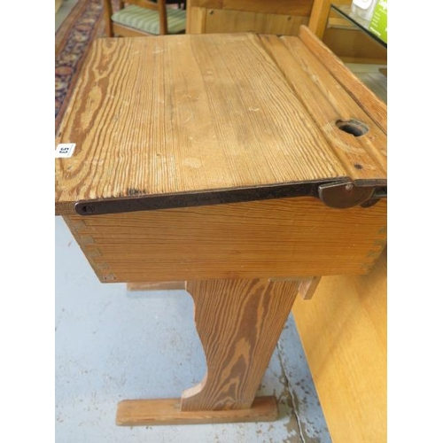 53 - A pitch pine school desk with hinged lid and inkwell recess, 81cm high, 58cm wide, 47cm deep, lackin...