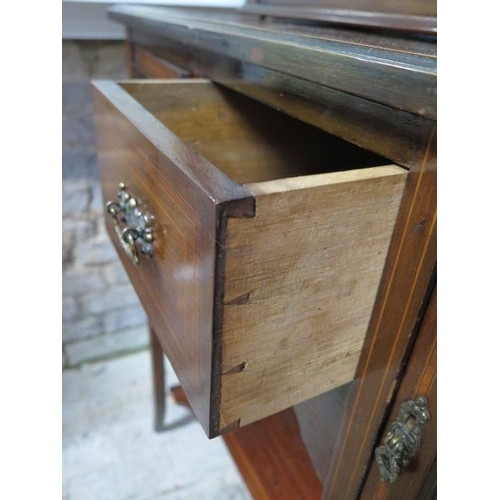 54 - An Edwardian mahogany and line inlaid display cabinet, with glazed hinged doors enclosing two shelve...