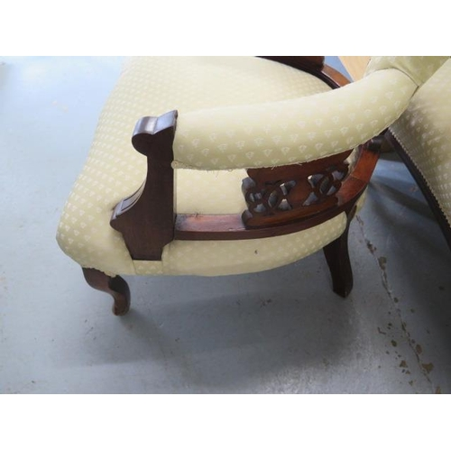 55 - An Edwardian mahogany and upholstered salon suite comprising sofa and two armchairs, with cream foli...