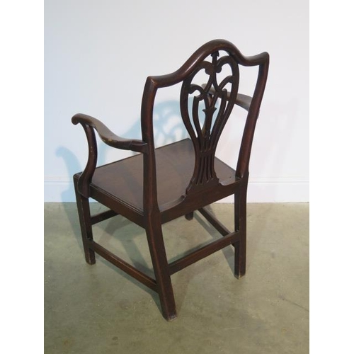 69 - A Georgian oak open armchair with solid seat, 98cm tall x 62cm wide