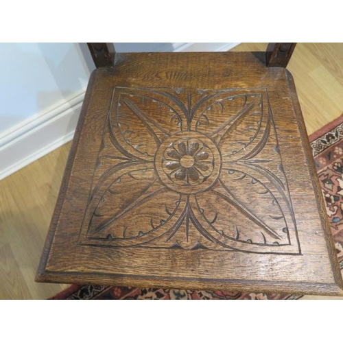 71 - A Victorian carved oak hall chair, 108cm tall x 46cm wide