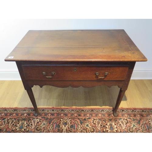 74 - A Georgian oak single drawer lowboy, 68cm tall x 93cm x 55cm