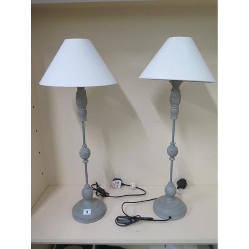 9 - A pair of metal painted table lamps with shades, 74cm tall