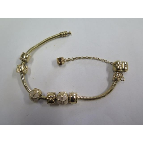 A Pandora 14ct yellow gold bracelet with six charms - approx 17cm long - approx 32.2 grams - in good condition, marked 585 ALE