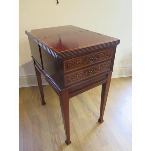 53 - An inlaid mahogany work table with two active drawers and a lift up top on square tapering legs, 69c...
