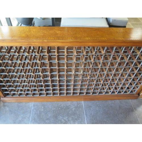 10A - A handmade walnut wine rack holding 190 bottles, 205cm wide x 108cm tall