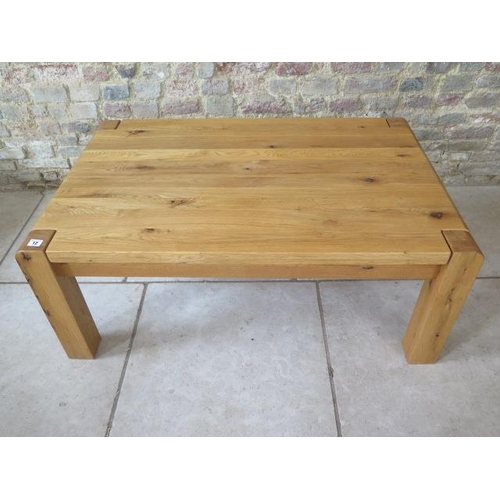 12 - A good quality oak coffee table in good condition, 110cm long x 70cm wide...