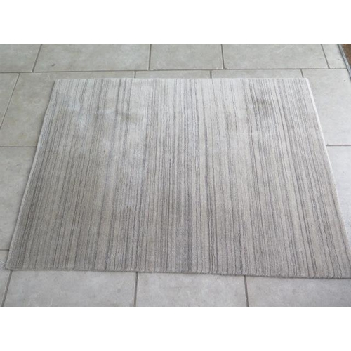 202 - A modern rug, 170cm x 125cm...