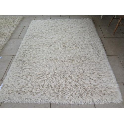 203 - A modern shag pile rug, 170cm x 140cm, by the Real Rug Company, made in India, in good condition