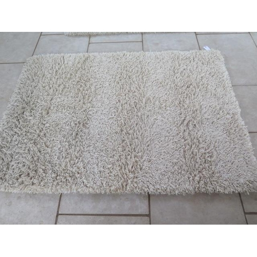 204 - A modern shag pile rug, 140cm x 200cm, by the Real Rug Company, in good condition...