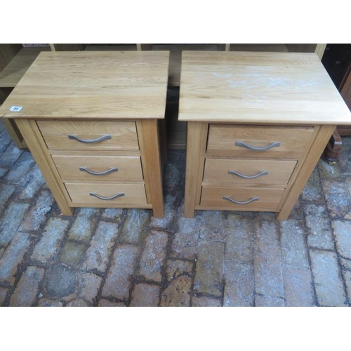21 - A pair of oak effect three drawer bedside chests, 57cm tall x 50cm x 40cm, generally good some marks...
