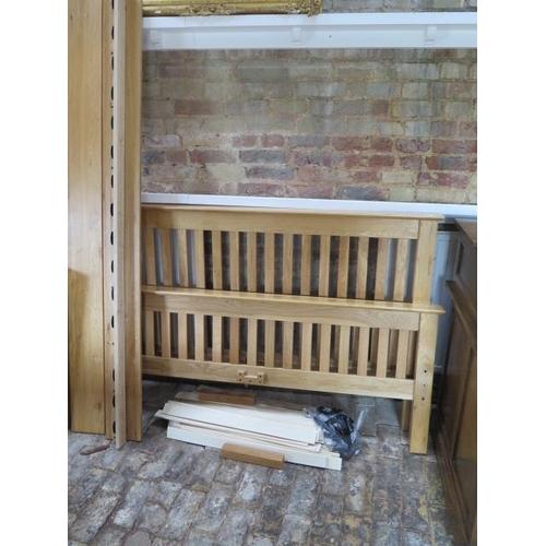 22 - An oak 5' double bed, headboard 42