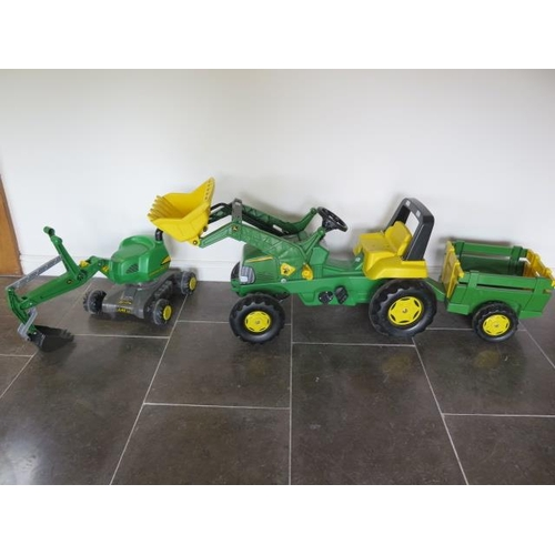 26 - A John Deere plastic pedal tractor with trailer and digger...