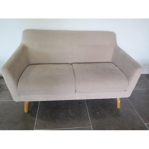 27 - An oatmeal two seater sofa, 77cm tall x 144cm x 84cm...