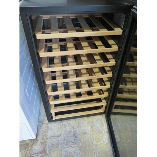 29 - A used Husky 34 bottle wine cooler model HUS-HN12, 83cm tall x 50cm x 43cm...