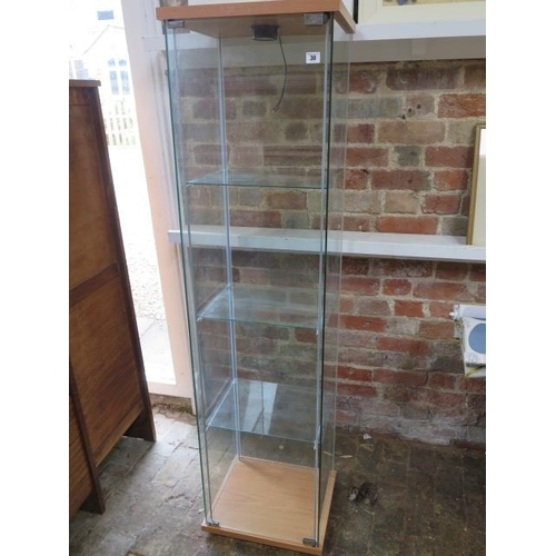 30 - A glass display cabinet with electric lighting, 164cm tall x 43cm x 37cm...