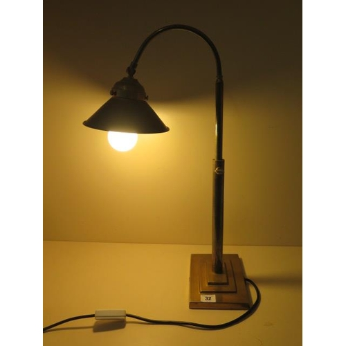 32 - A brass adjustable desk lamp in working order...