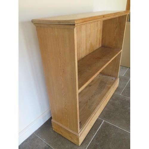 33 - A Victorian stripped pine open fixed shelf bookcase, 119cm tall x 127cm x 37cm