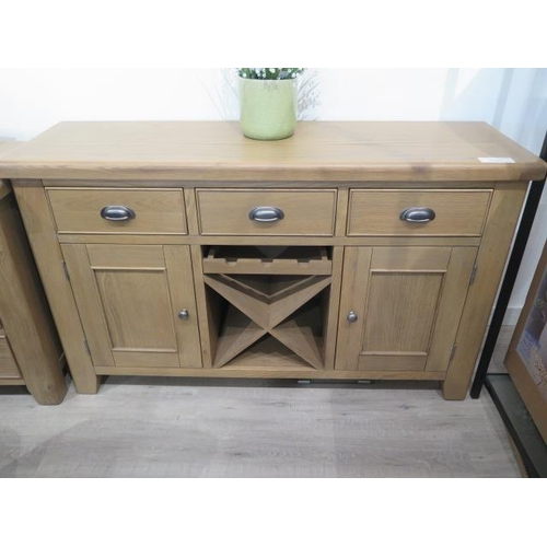 51A - A good quality oak sideboard with a wine rack, 150cm wide x 90cm tall, new ex-display, retails at £5...