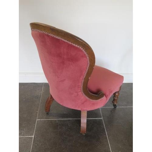 54 - A Victorian button back fireside chair, 88cm tall x 40cm seat height...