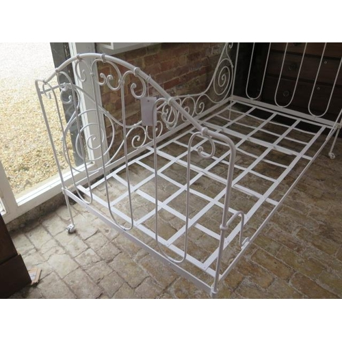 55 - A 20th century ornate wrought iron folding campaign bed, 109cm tall x 100cm wide x 188cm long, recen...