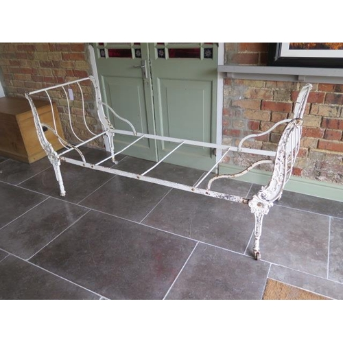 56 - A 19th century ornate case and wrought iron folding campaign bed, 88cm tall x 72cm wide x 186cm long...