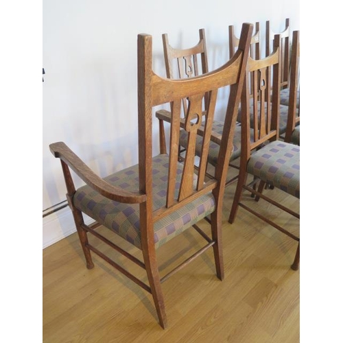 60 - A good set of eight oak Arts and Craft dining chairs including two carvers in the style of Charles V...