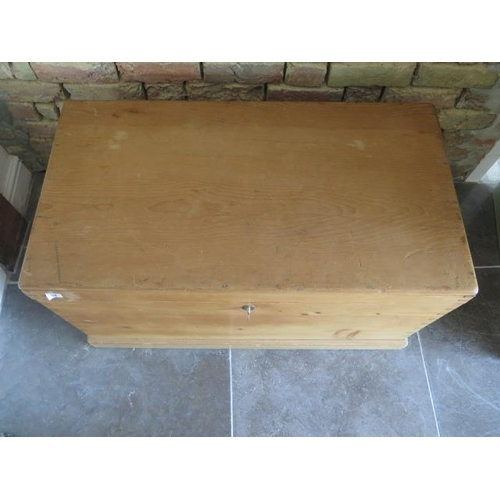 61 - A 19th century stripped pine storage box with two small internal drawers and key, 54cm tall x 94cm x...