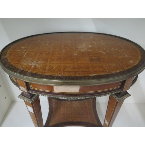 64 - A French style parquetry top oval side table with two drawers and oval mounts, some veneer losses bu...