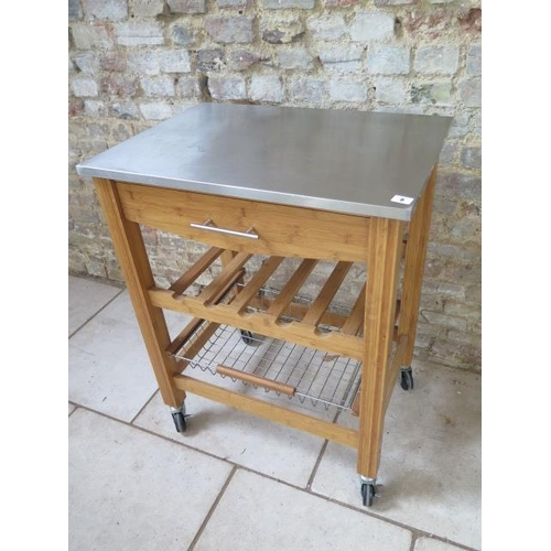 8 - A kitchen workstation with a stainless steel top on wheels, 70cm wide x 50cm deep...