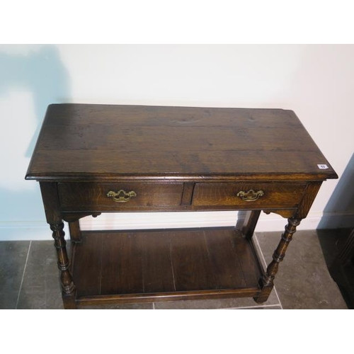 53 - A 19th century oak side table with two drawers and an undertier, 84cm tall x 97cm x 41cm, with good ...