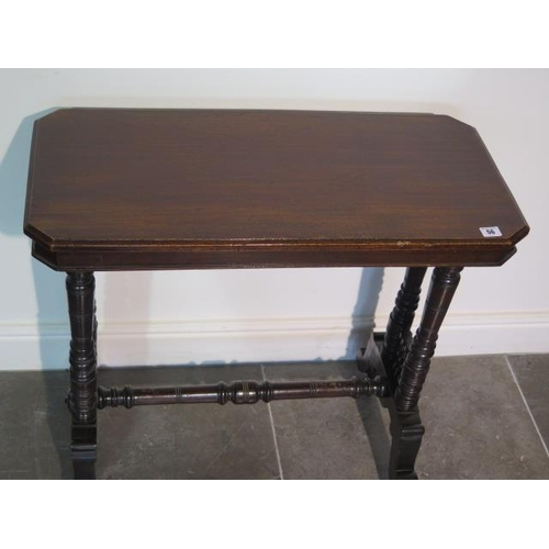 56 - A Victorian mahogany stretcher table, 71cm tall x78cm x 38cm