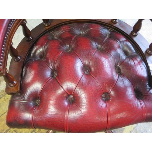 8 - A modern leather swivel office chair