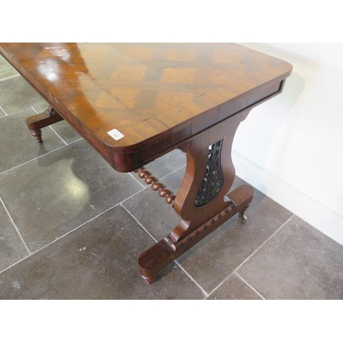 75 - A 19th century rosewood and burr walnut stretcher table on lyre end supports united by a barley twis...