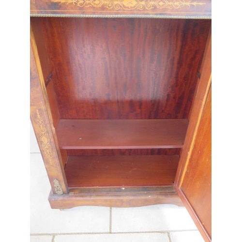 69 - A 19th century walnut inlaid pier cabinet with a single door and ormulu mounts, 112cm tall x 83cm x ...