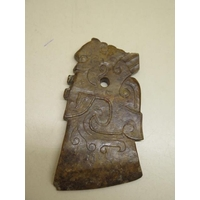 A russet carved jade pendant, 9cm x 5cm, small chips to three corners otherwise good