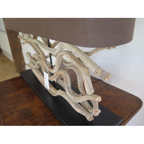 4 - A driftwood table lamp, 63cm tall x 80cm x 20cm, in working order