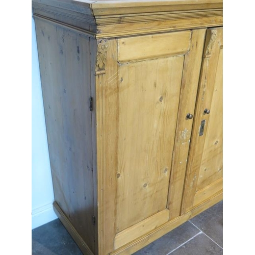 54 - A 19th century pine continental two door cupboard, 130cm tall x 120cm x 59cm ideal kitchen cupboard