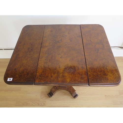 59 - A burr walnut dropleaf side table with a frieze drawer on an octagonal column and platform base, 77c...