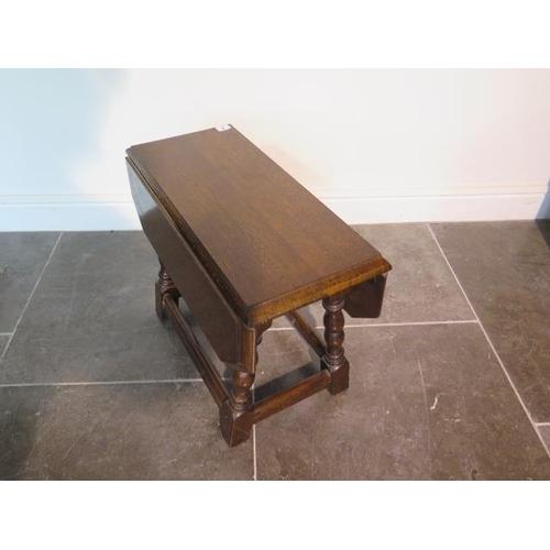 7 - An oak drop leaf coffee table, 45cm tall x 58cm x 58cm