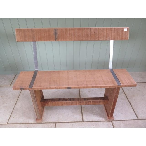 10 - A mahogany and steel garden bench made by a local craftsman, 89cm tall x 108cm wide x seat depth 25c...